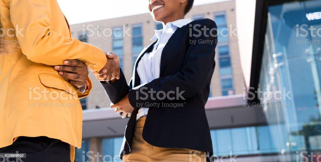 Close up photo of women handshake stock photo