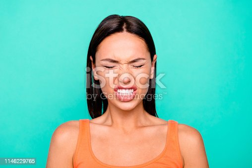 Close up photo portrait of unhappy sad upset angry grinning teeth she her lady millenial wearing casual tank top isolated pastel background.