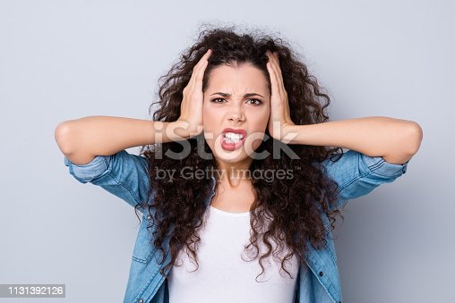 Close up photo stress amazing beautiful attractive her she lady hands arms shut hide ears terrible pain sick unwell despair wearing casual jeans denim shirt clothes outfit isolated grey background.