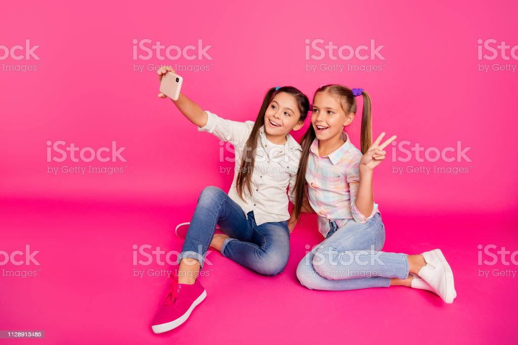 Close up photo two people little age she her girls hold hands arms...