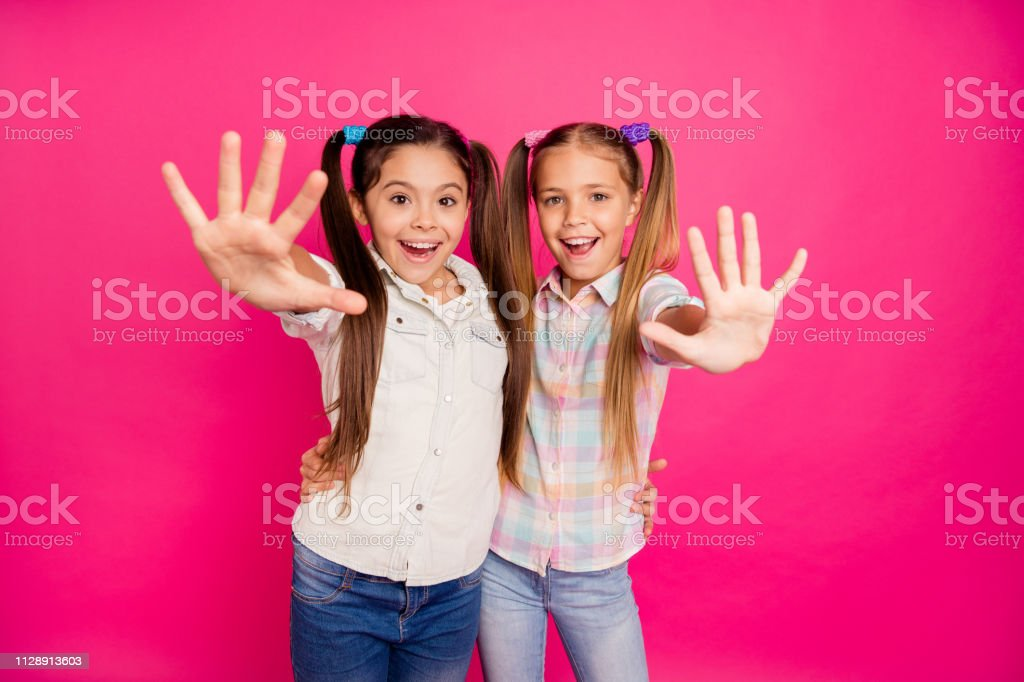 Close up photo two small little age she her girls hands arms palms counting fingers school lesson class wearing casual jeans denim checkered plaid shirts isolated rose vibrant vivid background – zdjęcie