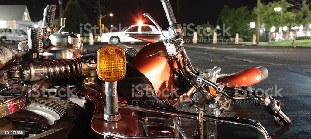 Close up photograph of a crashed motorcycle and police car stock photo
