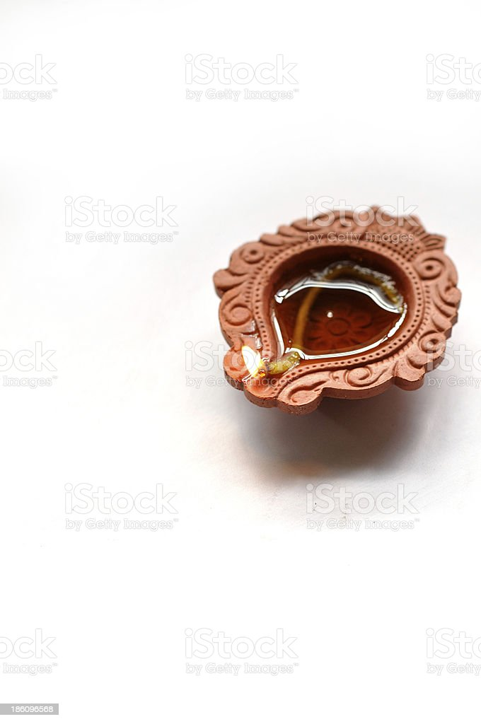 Close up photograph of a Diwali Diyas on a white background stock photo