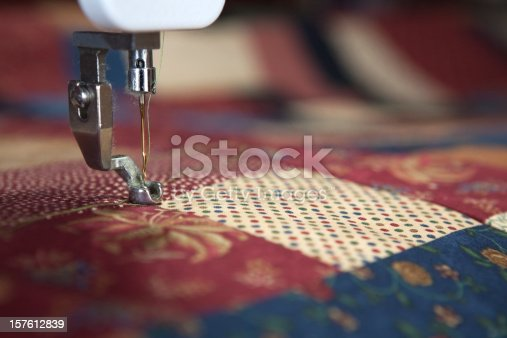 Sewing a quilt with quilting machine. Shallow depth of field.