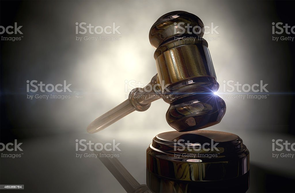 A close up photograph of a shiny justice gavel stock photo