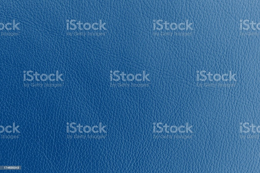 Close up photograph of blue dyed leather stock photo