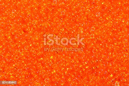 istock Close up photograph of yellow seed beads background 824185642