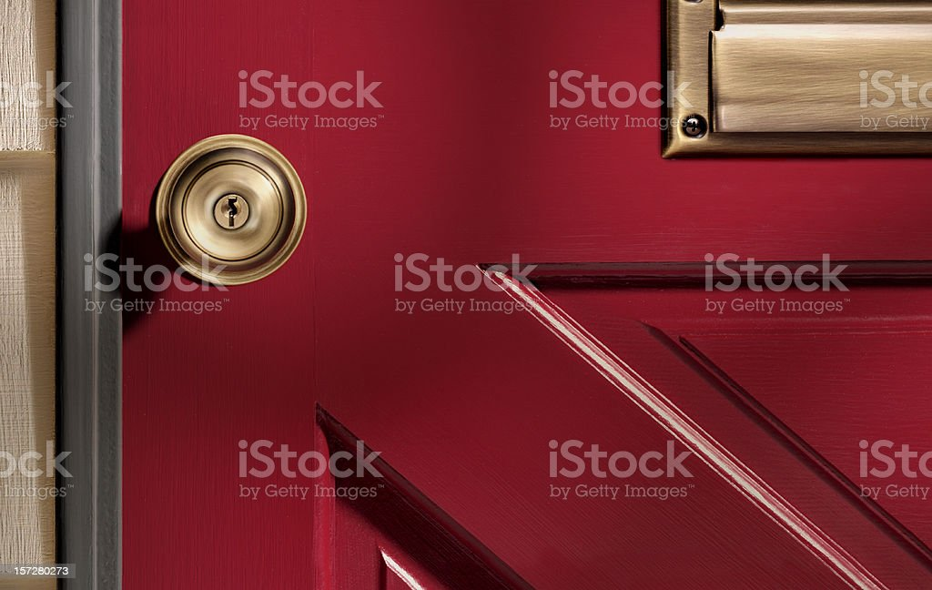 Close up picture of a doorknob on a red door stock photo