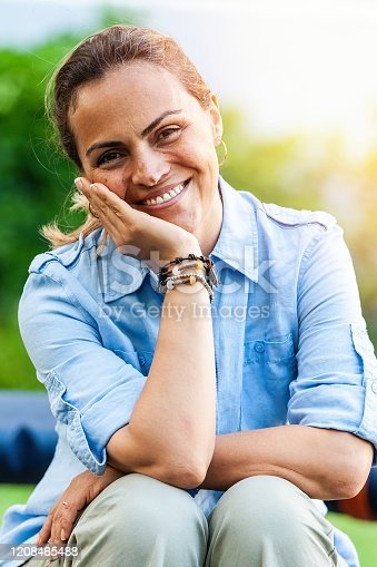 825083304 istock photo Close up picture of a smiling mature hispanic woman outdoors 1208465488