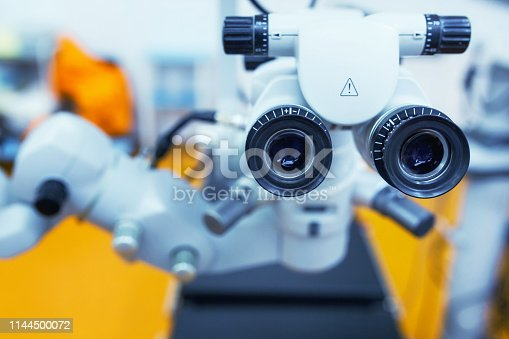 istock close up picture of an operating microscope in a laboratory. Ophthalmologist. medical, health, ophthalmology concept 1144500072