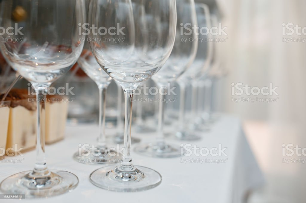 Close up picture of empty glasses on the beige tablecloth  in restaurant royalty-free stock photo