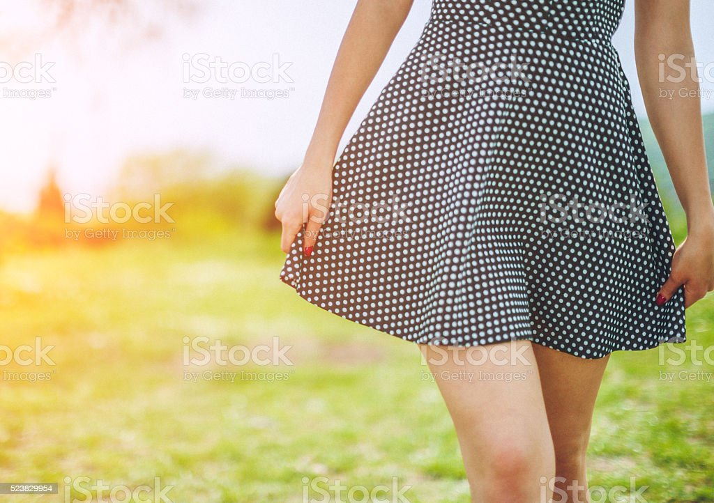 close up picture of female legs with short dress stock photo
