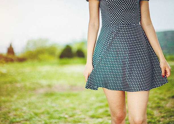 close up picture of female legs with short dress - mini dress stock photos and pictures