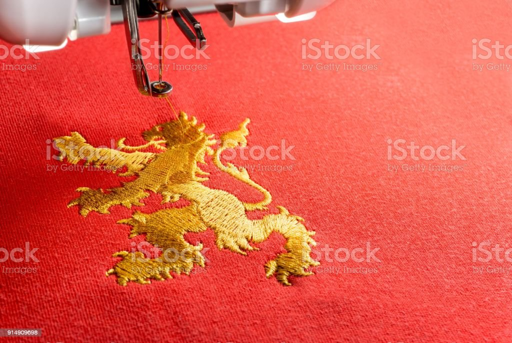 Close up picture of gold lion design embroider by machine stock photo
