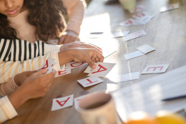 close up picture of human hands putting the cards on the table - word game stock pictures, royalty-free photos & images