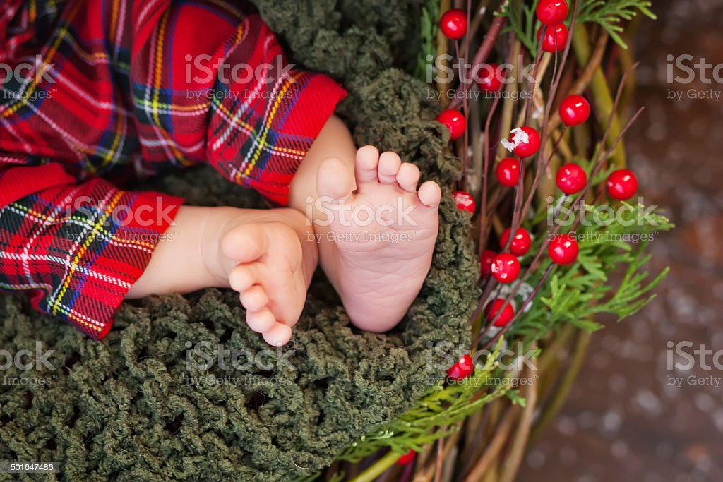 Close up picture of new born baby feet, christmas time stock photo