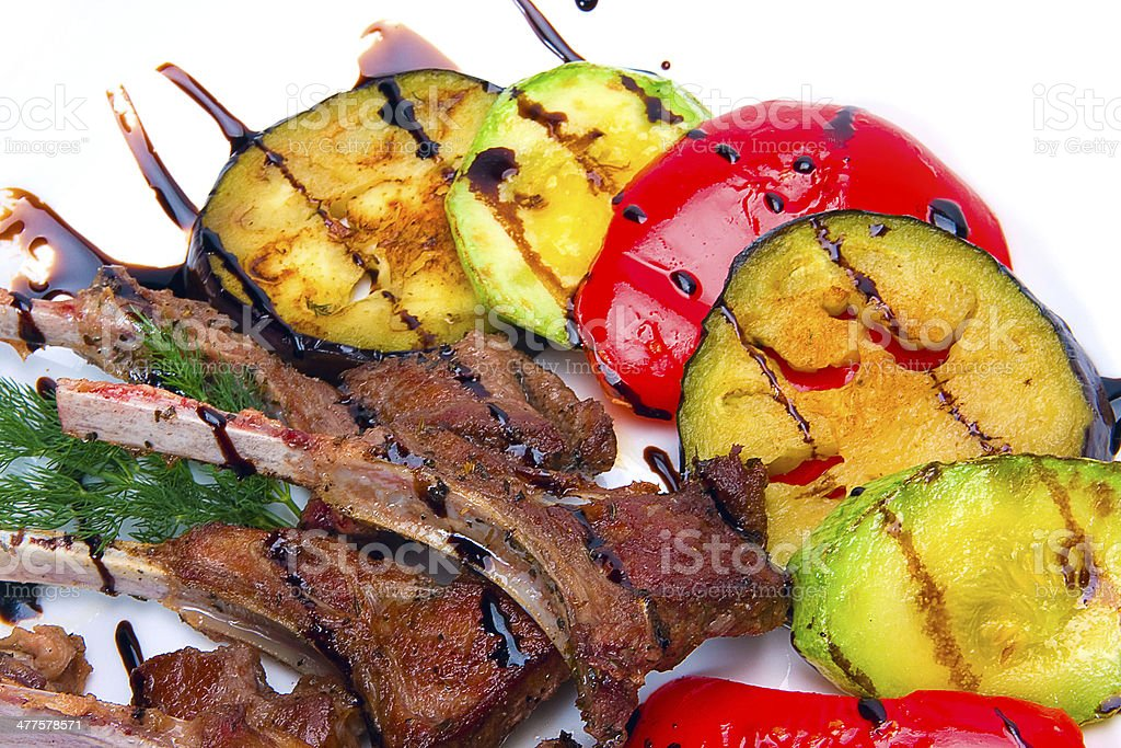 Close up picture of roasted and vegetables on white royalty-free stock photo