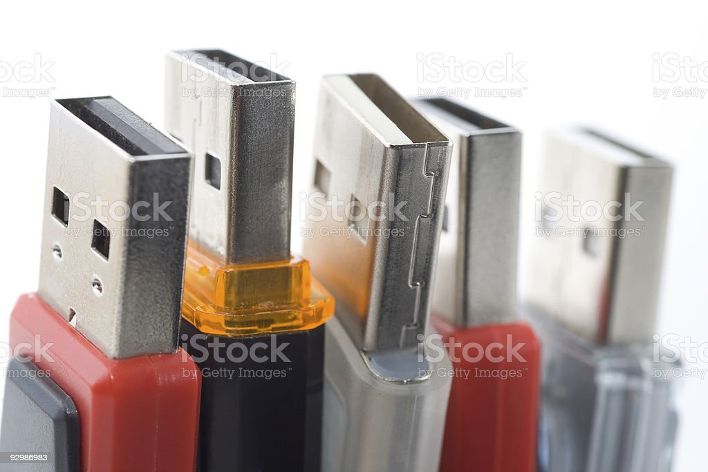 A close up picture of several different flash drives  stock photo