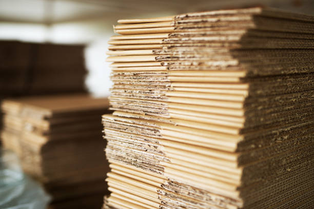 close up picture of stacks of folded brown cardboard. - packaging foto e immagini stock