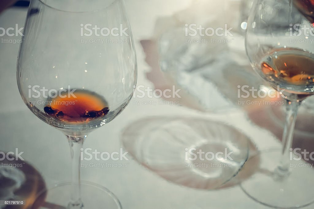 Close up picture of wine glasses in restaurant stock photo