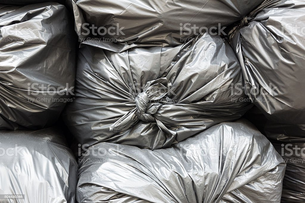 Close up pile of black garbage bags stock photo