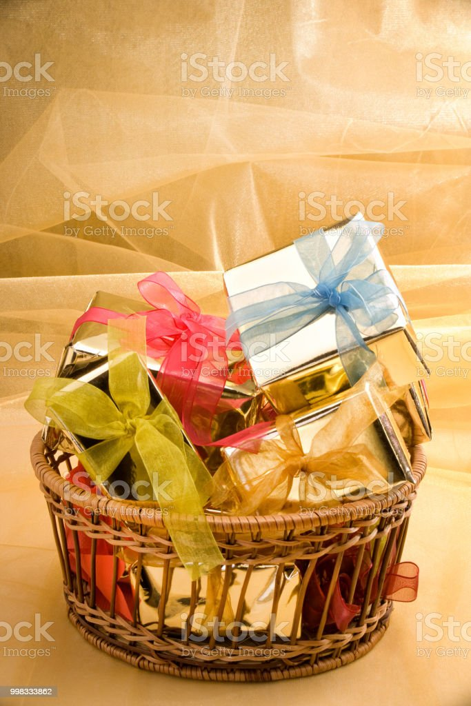 Close up studio shot of pile of colorful gift box arrangement in...