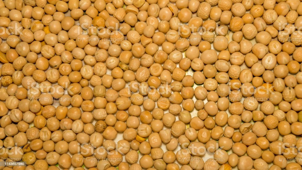 Close Up Pile Of Yellow Gram Flour Beans Texture Background