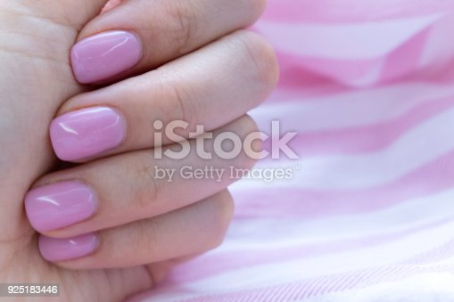 1128559926 istock photo Close up pink nails for girls. Stylish trendy female manicured fingernails. Beautiful young woman's hands on pink and blue background. Top view, flat lay. copy space for text 925183446
