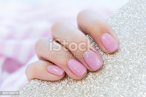 1128559926 istock photo Close up pink nails for girls. Stylish trendy female manicured fingernails. Beautiful young woman's hands on pink and blue background. Top view, flat lay. copy space for text 925183576
