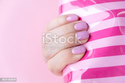 1128559926 istock photo Close up pink nails for girls. Stylish trendy female manicured fingernails. Beautiful young woman's hands on pink and blue background. Top view, flat lay. copy space for text 925183626