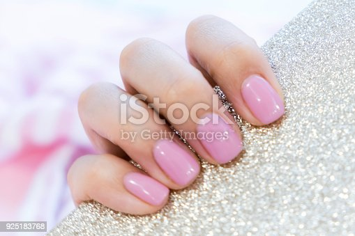 1128559926 istock photo Close up pink nails for girls. Stylish trendy female manicured fingernails. Beautiful young woman's hands on pink and blue background. Top view, flat lay. copy space for text 925183768