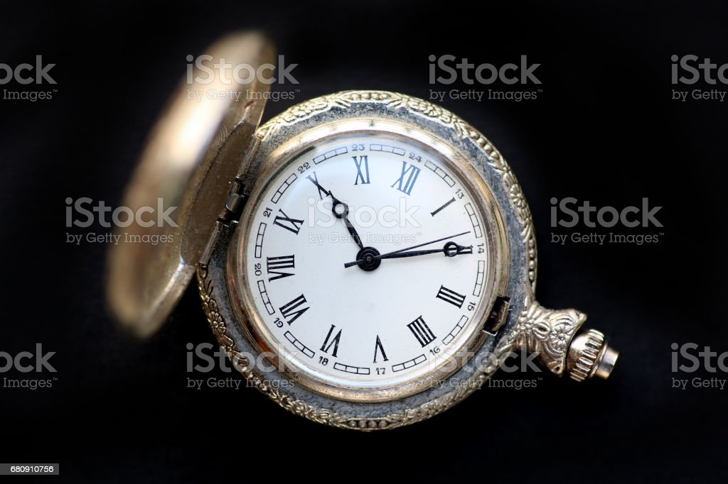 Close up pocket watch on black background. royalty-free stock photo