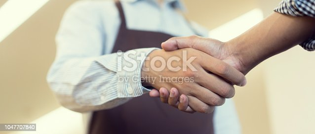 924520168 istock photo close up  politeness of businessman (owner) handshake with customer in front o shop after purchased or deal successful , financial cooperative and good manners people concept. 1047707840