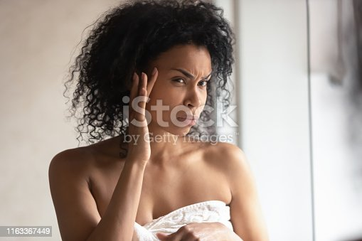istock Close up portrait 30s woman found facial wrinkles feels worried 1163367449