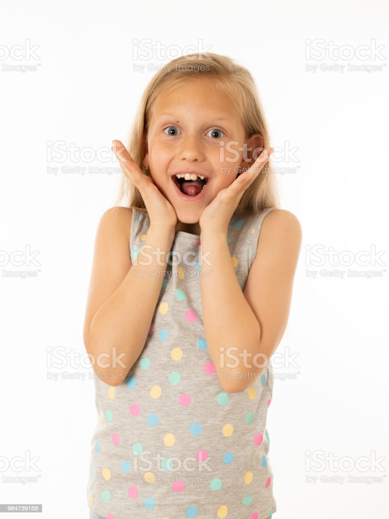 Close up portrait. Cute charming happy, excited, funny, cheerful young kid with a shocked, surprised face looking at the camera. Positive human emotions, body language and feelings. White background royalty-free stock photo