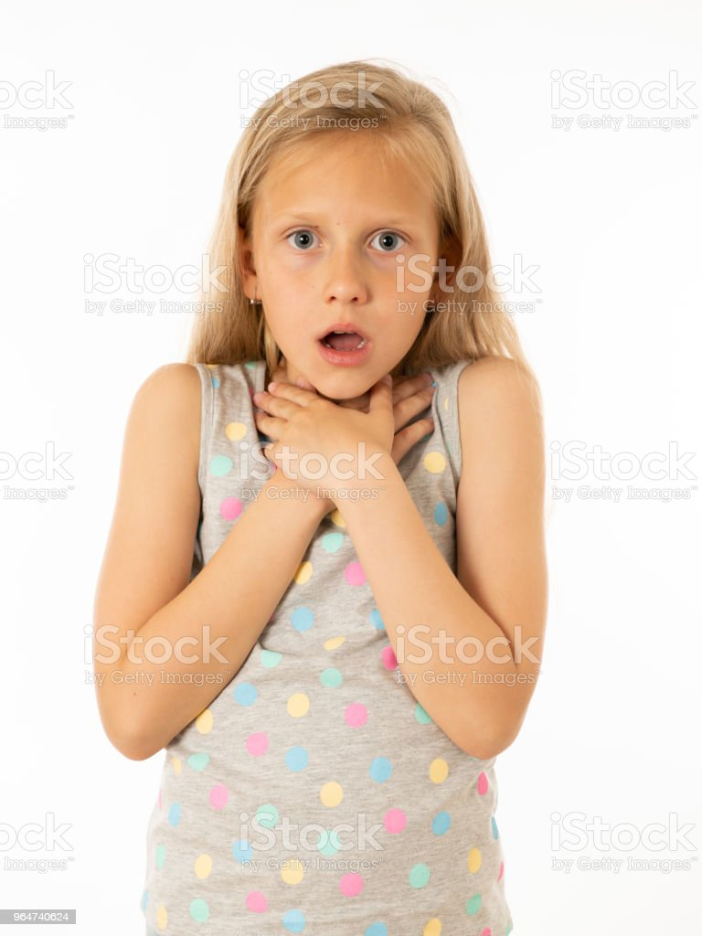 Close up portrait. Cute, scared young kid with a shocked, surprised face hands covering her mouth with fear. Human emotions, body language and facial expressions. White background royalty-free stock photo