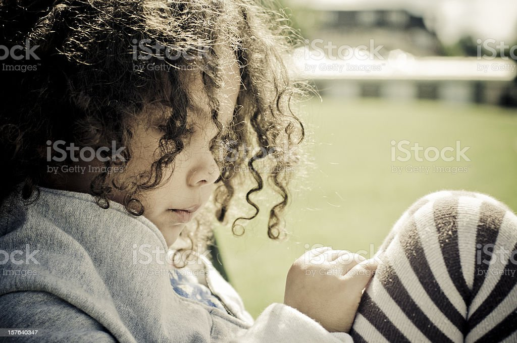 Close up Portrait of 4 years old Girl Looking Pensive royalty-free stock photo