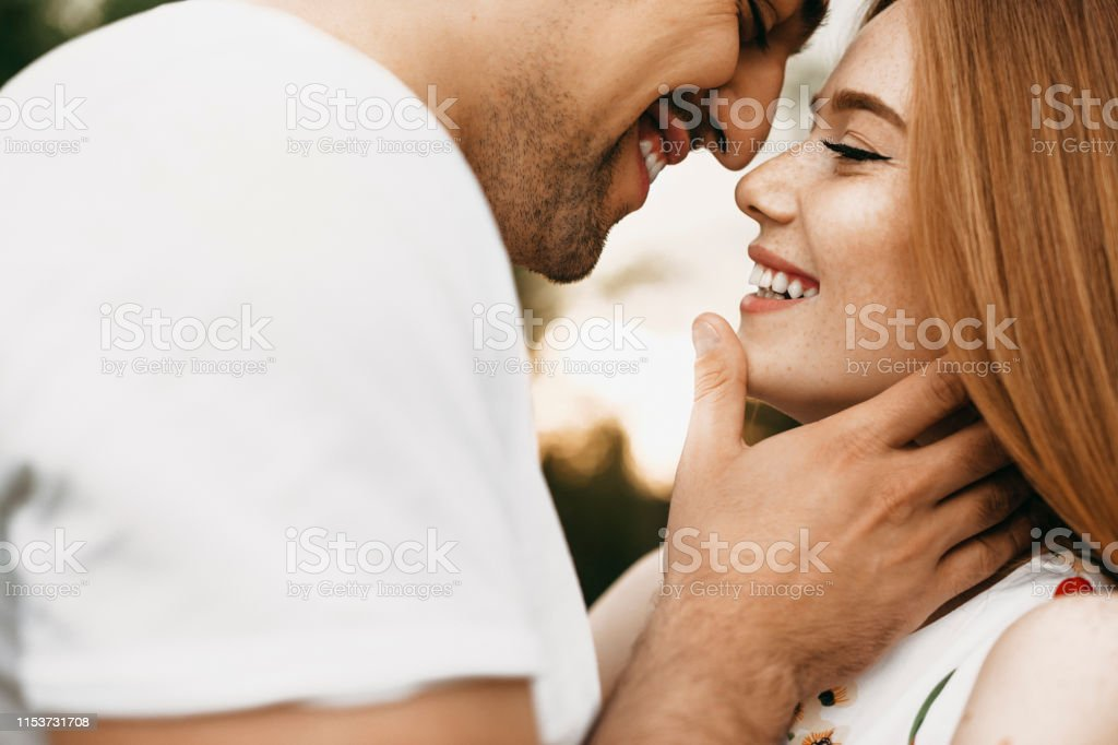 Close up portrait of a beautiful caucasian couple smiling face to...