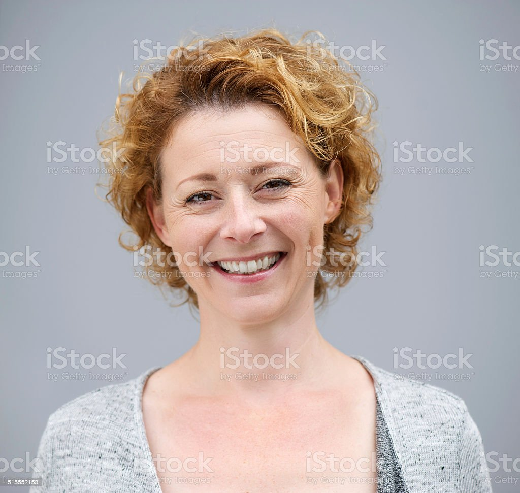 Close up portrait of a beautiful woman smiling stock photo