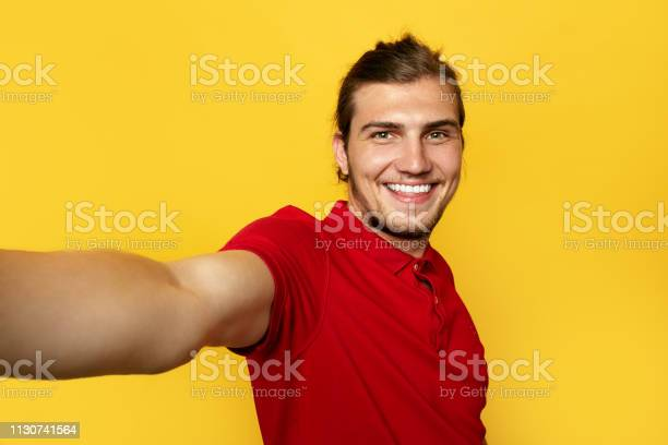 Close up portrait of a cheerful bearded man taking selfie over yellow picture id1130741564?b=1&k=6&m=1130741564&s=612x612&h=k cfimvrzqyh dhdy99mehk7yau esinvnlikwnu00u=