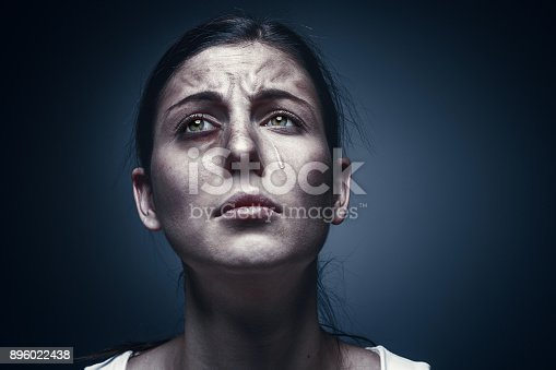 896025292 istock photo Close up portrait of a crying woman with bruised skin and black eyes 896022438