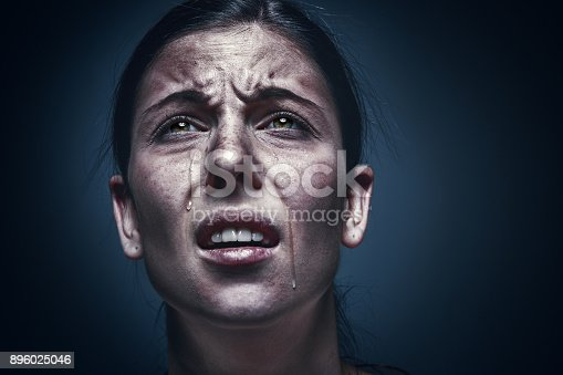 896025292 istock photo Close up portrait of a crying woman with bruised skin and black eyes 896025046