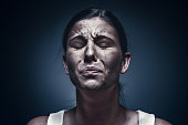 istock Close up portrait of a crying woman with bruised skin and black eyes 896025292