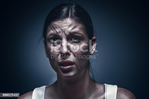 896025292 istock photo Close up portrait of a crying woman with bruised skin and black eyes 896025432
