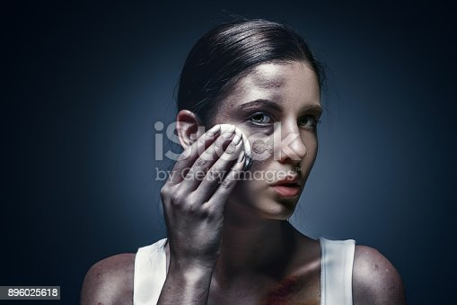 896025292 istock photo Close up portrait of a crying woman with bruised skin and black eyes 896025618