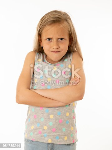 Close Up Portrait Of A Cute Pretty Child Looking Angry And Disappointed With Her Arms Crossed Isolated White Background Human Emotions Facial Expressions Body Language And Feelings Stock Photo & More Pictures of Anger