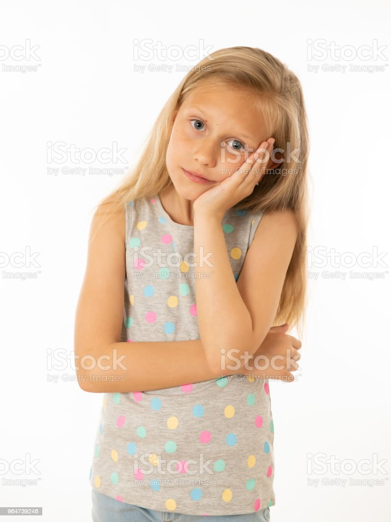 Close up portrait of a cute pretty child looking angry and disappointed with her arms crossed. Isolated white background. Human emotions, facial expressions, body language and feelings royalty-free stock photo