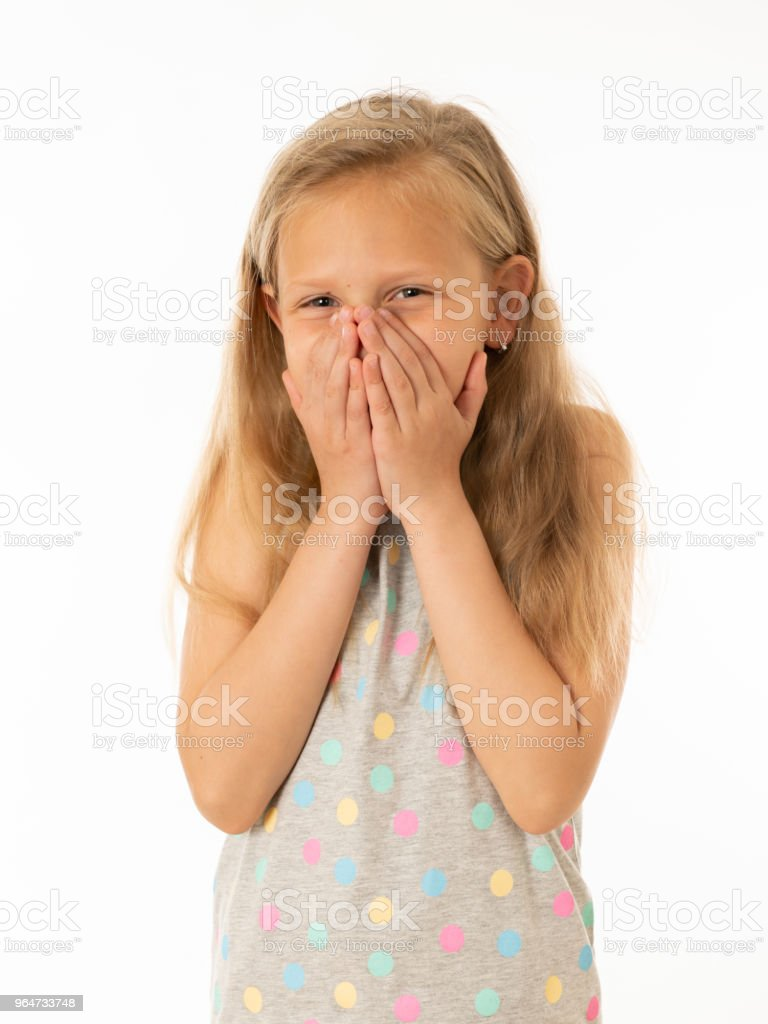 Close up portrait of a cute young shy girl looking timid at the camera on a white background. In facial expression photo concept royalty-free stock photo