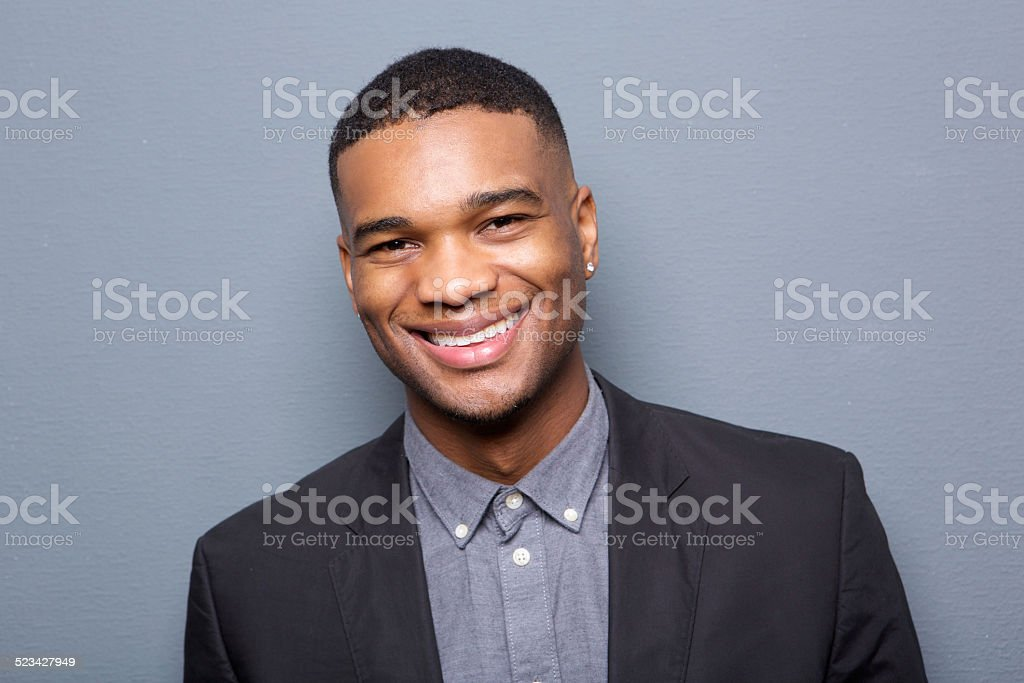 Close up portrait of a fashionable black man smiling stock photo