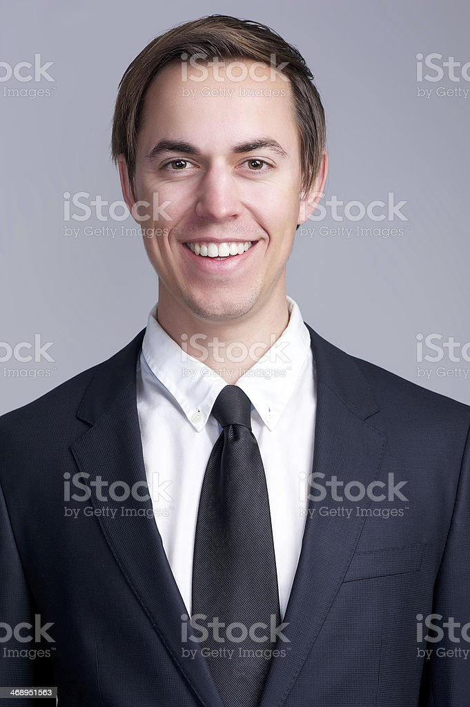 Close up portrait of a happy businessman in suit smiling royalty-free stock photo